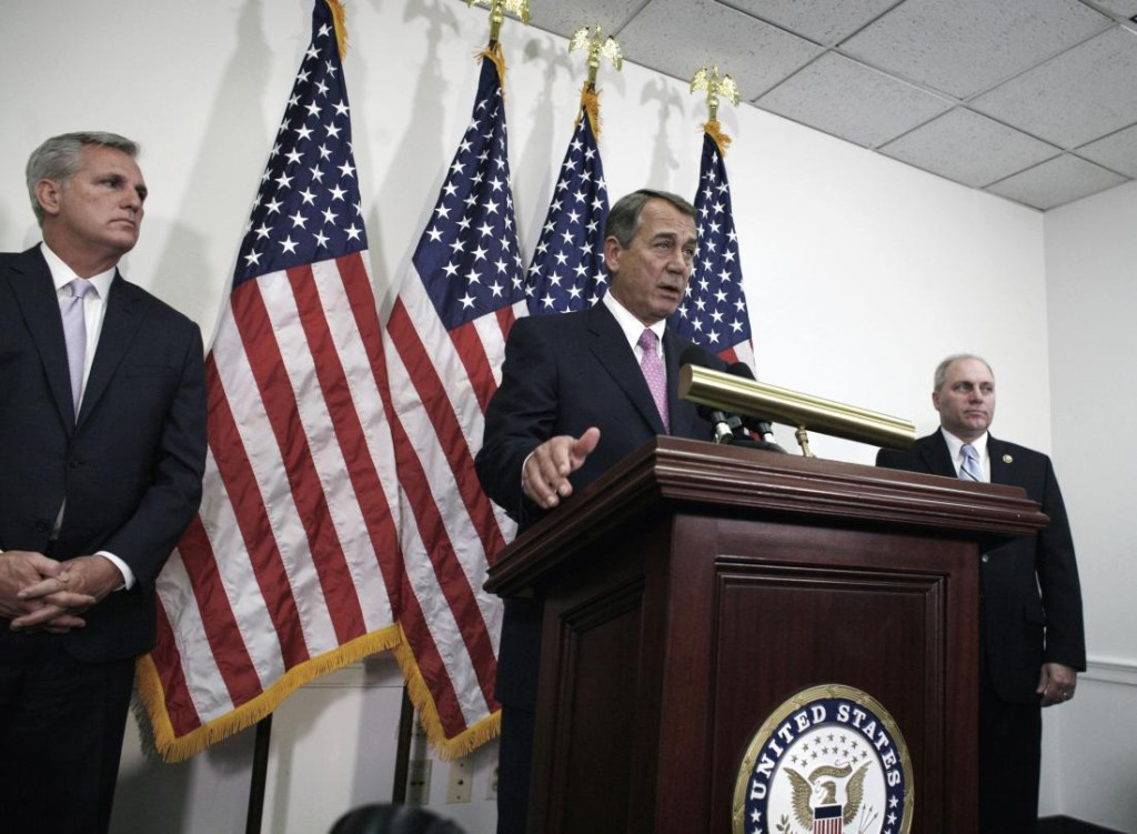 Outgoing House Speaker John Boehner of Ohio, center, flanked by House Majority Leader Kevin McCarthy of Calif., left, and House Majority Whip Steve Scalise of La., talks with reporters on Capitol Hill in Washington, Tuesday, Oct. 27, 2015. House Republican leaders on Tuesday pushed toward a vote on a two-year budget deal despite conservative opposition, relying on the backing of Democrats for the far-reaching pact struck with President Barack Obama. In his last days as speaker, John Boehner was intent on getting the measure through Congress and head off a market-rattling debt crisis next week and a debilitating government shutdown in December. The deal also would take budget showdowns off the table until after the 2016 presidential and congressional elections, a potential boon to the eventual GOP nominee and incumbents facing tough re-election fights. (AP Photo/Lauren Victoria Burke)